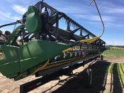 Image for article Used 2013 John Deere 635F Header Combine